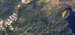 antalyada denize yakın yerlerde arsa yatırımlık araziler ve evler